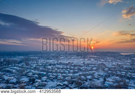 sunrise over city of Fort Collins in after heavy snowstorm, aerial view of late winter or erly spring scenery