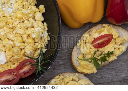 Scrambled Eggs, Delicious Breakfast With Herbs And Tomatoes