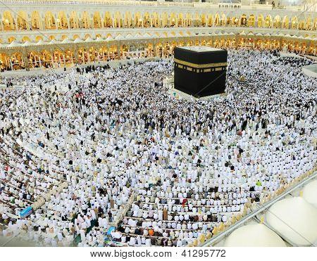 MAKKAH - JULY 21 : A crowd of pilgrims circumabulate (tawaf) Kaaba on July 21, 2012 in Makkah, Saudi Arabia. Pilgrims circumambulate the Kaaba seven times in counterclockwise direction.