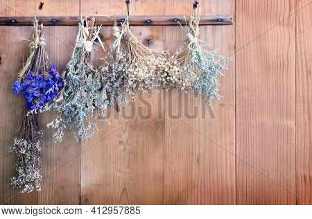 Hanking Dry Flower For Aromateraphy At Wood Door For Background