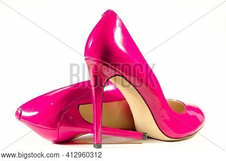 Beautiful Female Shiny Pink Stilettos On A White Background
