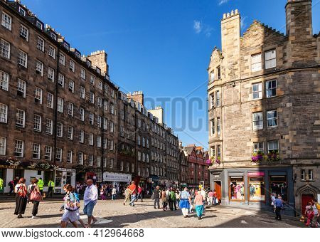 Edinburgh, UK - Aug 9, 2012: Tourists strolling along the Lawnmarket, a popular tourist attraction in the Old Town