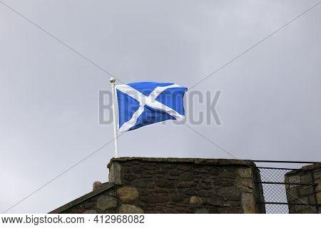 Blackness (scotland), Uk - August 15, 2018: A Scotland Flag On Blackness Castle, Blackness, Scotland