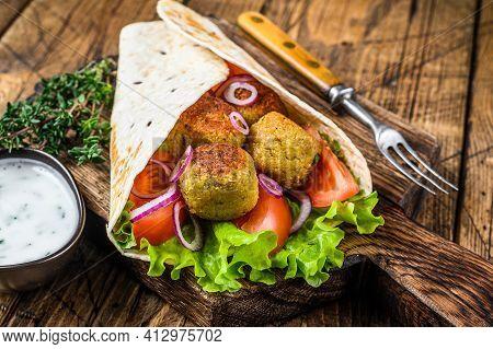 Vegetarian Tortilla Wrap With Falafel And Fresh Salad, Vegan Tacos. Wooden Background. Top View