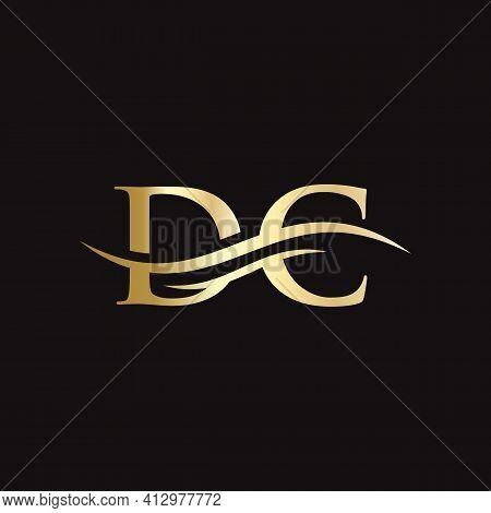 Dc Logo Design. Premium Letter Dc Logo Design With Water Wave Concept.