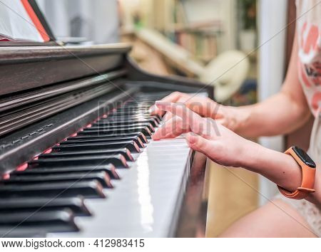 Piano Private Lesson. Young Woman Teaches A Kid To Play The Piano. Playing Together. Master Teaches