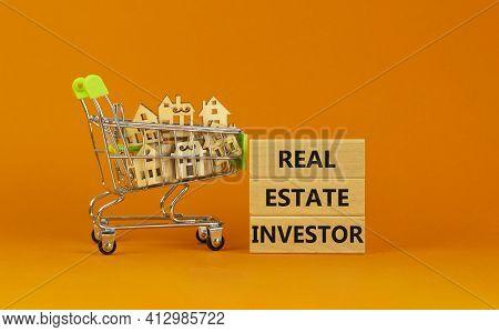 Real Estate Investor Symbol. Wooden Blocks, Words 'real Estate Investor' On Beautiful Orange Backgro