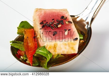 Close Up Of Rare Seared Ahi Tuna Slices With Fresh Vegetable Salad On A Plate. Shallow Dof