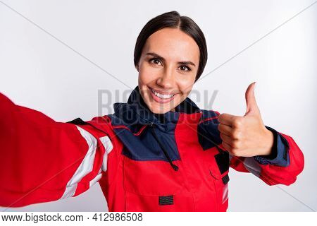 Photo Of Young Woman Paramedic Happy Positive Smile Make Selfie Show Thumb-up Like Cool Advert Isola