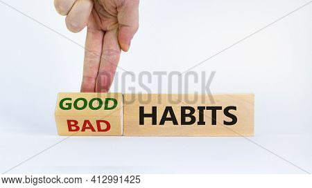Good Habits Symbol. Businessman Turns A Wooden Block And Changes Words 'bad Habits' To 'good Habits'