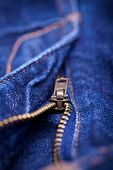 Macro Detail of a blue jeans zipper with a shallow DOF poster