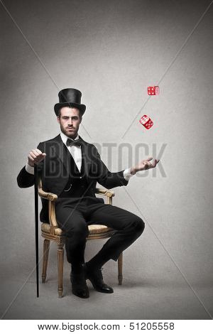 very rich businessman sitting on a chair with dice