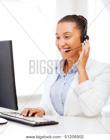 business, office and communication concept - african female helpline operator with headphones