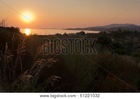 Sunset at Toroni bay with Aegean sea and mount Olimp in background