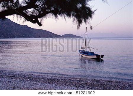Small Boat On Quiet Sea