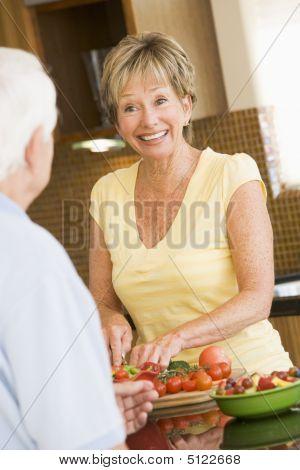 Husband And Wife Preparing Vegetables