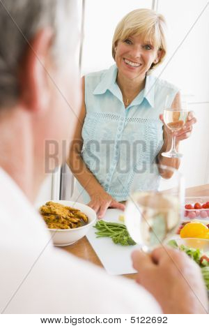 Cooking Couple Cutting Food Healthy Kitchen Preparing Toasting 50s Caucasian Chopping Color Colour Dinner Domestic Enjoying Enjoyment Fifties Happy Holding Home Home Cooking Husband Image Indoors Knife Lunch Man mealmealtime mealmealtimetimes Middle Aged  poster
