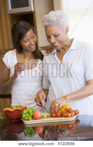 Mother And Daughter Preparing A Meal, Mealtime Together