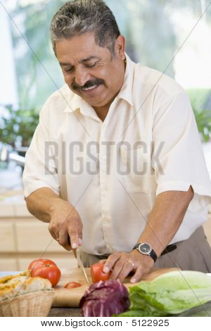 middle agedmanChopping Cooking Dinner Food Healthy Preparing Vegetables 50s Casual Clothing Color Colour Cutlery Cutting Domestic Domestic Life Eating Enjoying Enjoyment Fifties Happy Healthy Eating Hispanic Holding Home Home Cooking Image Indoors Inside  poster