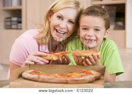Mother And Son Eating Pizza Together