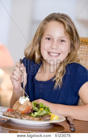 Young Girl Eating Meal, Mealtime