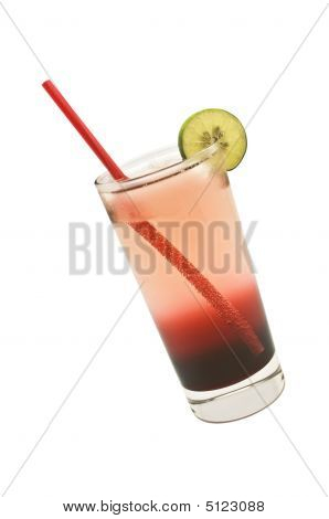 Two-toned Drink In A Tall Glass With Red Straw And A Slice Of Lime