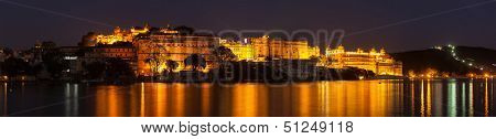 Romantic luxury India travel tourism - City Palace complex on Lake Pichola in twilight, Udaipur, Rajasthan, India