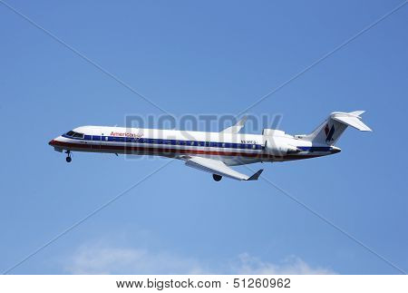 American Eagle Bombardier CRJ-700 plane in New York sky before landing in La Guardia Airport