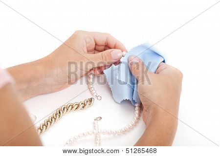 Woman Cleaning A Jewelry