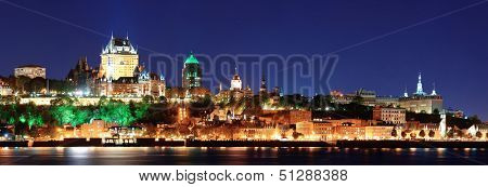 Quebec City skyline panorama at dusk over river viewed from Levis. poster