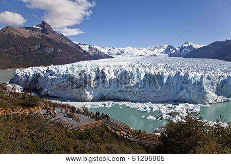 People Looking At The Perito Moreno Glaciar.