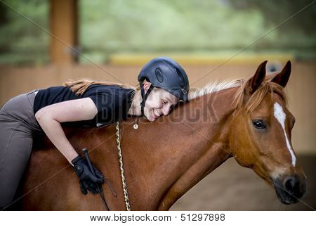 Young happy woman on her horse