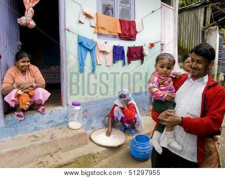 Darjeeling - October 2010: Proud Family In The Slums Of Darjeeling
