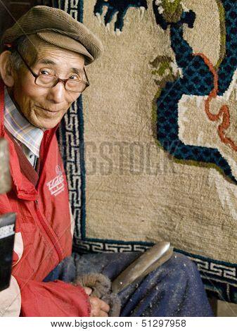 Darjeeling, India - October 18, 2010: Man In A Tibetan Refugee Centre