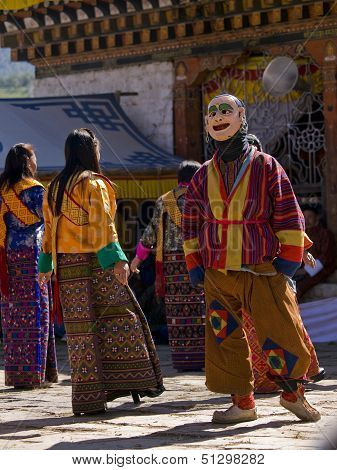 Jakar, Bhutan - October 24, 2010: Man And Women Wearing Kira Dresses Are Dancing At The Jakar Tsechu