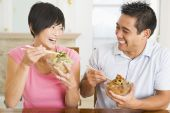 Couple Eating Food Healthy Eating Home Cooking mealmealtime 30s Asian Casual Clothing Chinese Chopsticks Color Colour Dining Room Domestic Life Enjoying Happy Holding Home Horizontal Husband Image Indoors Inside Looking At Camera Looking At Each Other Man poster