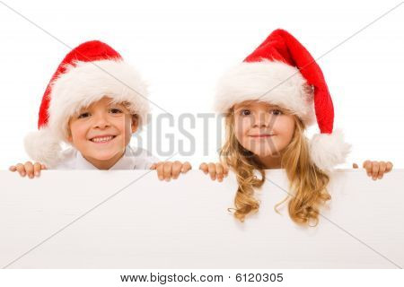 Happy Christmas Kids With White Sign - Isolated