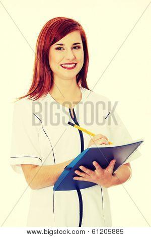 Smiling medical doctor or nurse.