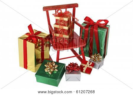 Christmas presents around red rocking chair on white background