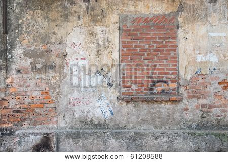 Bricked Up Window In A Weathered Wall
