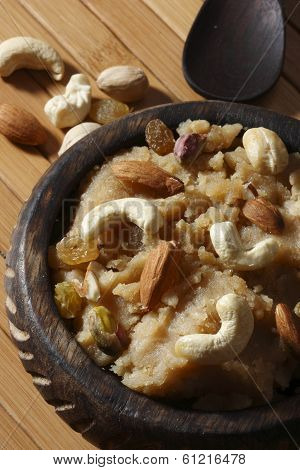 Atte ji sero is flour based dessert made with wheat flour ghee and dry fruits poster