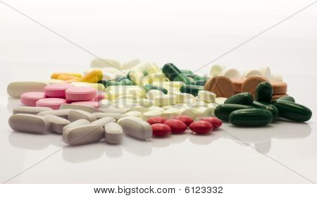 Colorful Pills Over White