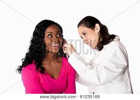 Happy smiling doctor physician checking patient ear for infection with otoscope isolated. poster
