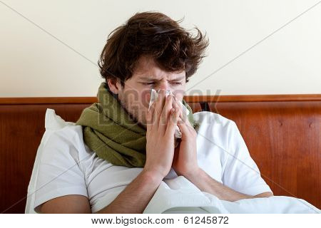 Man With Running Nose In Bed