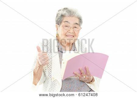 An old woman reading a book