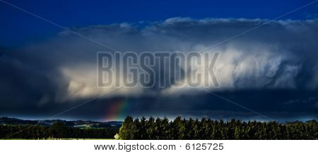 Storm Cloud With Rainbow