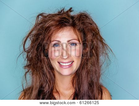 smiling happy woman with crazy hair