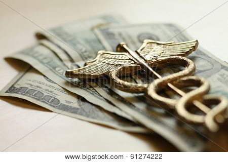 Expensive healthcare concept, caduceus on US money