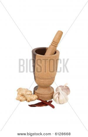 Wooden Mortar With Dried Chillis, Fresh Ginger And Garlic