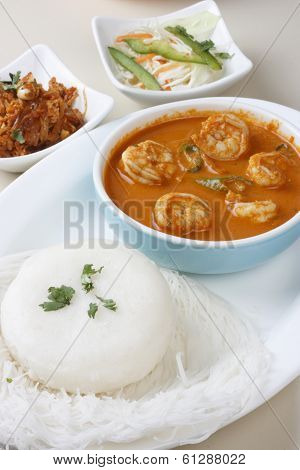 Top view of Goan Prawn Curry which is made from fresh prawns and spices and this can be eaten with idly or rice. This is a very popular dish in India. poster